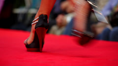 Model walking on runway during fashion show Stock Footage