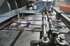 cover binding. book, magazine, catalog production line into press plant house - stock photo