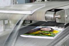 Book, magazine production line into press plant house. binding product. Stock Photos