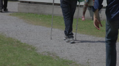 Walking with crutch Stock Footage