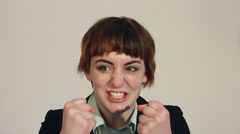 Business woman triumphant double fist pump Stock Footage