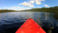 Stock Video Footage of POV adventurous view of  Kayak remote lake, USA
