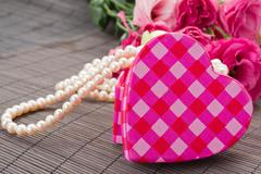 heart box with pearls and flowers - stock photo