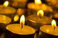 Stock Photo of burning candles with shallow depth of field
