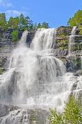 powerful upper falls of the tvindefossen - stock photo