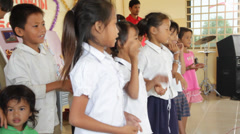 Little Cambodian Orphans Singing with Signs Stock Footage