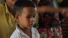 Little Cambodian Orphan Boy Looking Confused Stock Footage