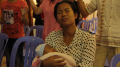 Cambodian Woman with Child Worshiping Stock Footage