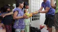 Little Cambodian Orphans Receiving Food Stock Footage