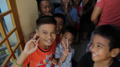 Cambodian Orphans Showing the Peace Sign Stock Footage