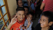Stock Video Footage of Cambodian Orphans Showing the Peace Sign