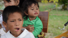 Little Cambodian Orphans Eating Bread Stock Footage