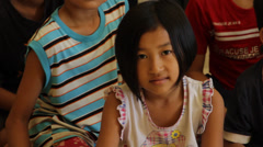 Little Cambodian Orphan Girl Looking at Camera Stock Footage