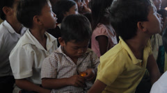 Little Cambodian Orphan Boy Playing with a Toy Stock Footage