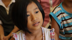 Beautiful Cambodian Orphan Girl Paying Attention Stock Footage
