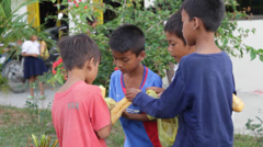 Poor Orphan Kids Eating Bread, Cambodia Stock Footage