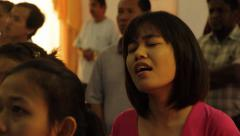 Cambodian Girl Singing in Church Stock Footage