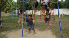 Orphan Kids from Cambodia Playing Outside Stock Footage