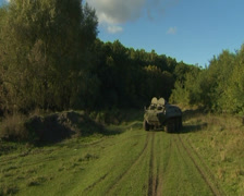 Armored personnel carrier rides on the field Stock Footage