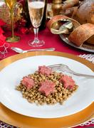 pig trotter star shaped with lentils over christmas table - stock photo