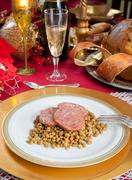 Slices of pig trotter with lentils over christmas table Stock Photos