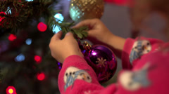 Close up of child hanging a Christmas ornament - stock footage