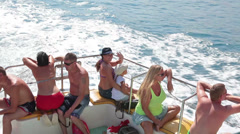 People sitting on deck of recreational marine ship. Floating in Mediterranean Stock Footage