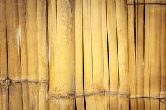 old wall from the tied up wooden planks. - stock photo