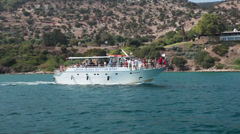 Recreational marine boat with people on a board floating in Mediterranean Sea Stock Footage