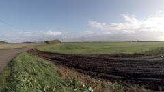 Farmland fields in the Cambridgeshire fens England Stock Footage