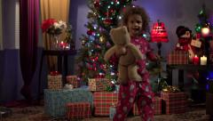 Little girl running for Christmas presents - stock footage
