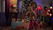 Stock Video Footage of Little girl running for Christmas presents