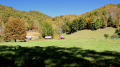Rustic red barns farm autumn mountain Stock Footage