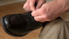 Man tying black dress shoe Stock Footage