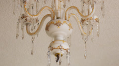 Chandelier ceiling lamp swinging during earthquake, hurricane, storm or tornado. Stock Footage