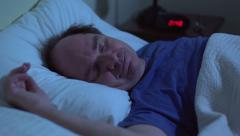 Older man sleeping comfortably - stock footage