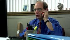 Slider shot of successful businessman on phone Stock Footage
