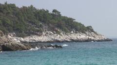 Beautiful bay, rocky coast, crashing waves, paradise beach Stock Footage
