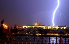 lightning over the prague castle during thunderstorm. - stock photo