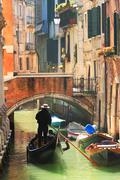 Gondola on canal in venice, italy. Stock Photos