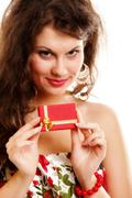 girl opening small red gift box isolated - stock photo