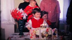 Family and friends gather for little girls birthday, 150 vintage film home movie Stock Footage