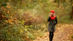 Beautiful fashion woman smoking cigarettes in park Stock Footage