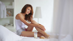 Attractive woman caressing her leg - stock footage