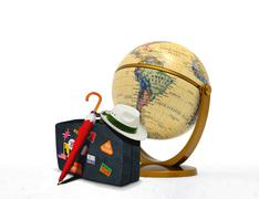 Travel suitcase with hat and globe Stock Photos