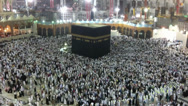 Stock Video Footage of Muslim pilgrims circumambulate the kaaba in Mecca, Saudi Arabia.