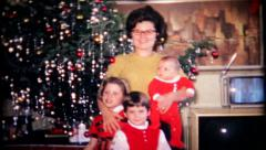 Mom and the kids pose for a Christmas portrait,151 vintage film home movie Stock Footage