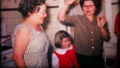 152 - drinks & fun with family on Grandma's birthday - vintage film home movie Stock Footage