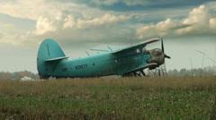 Blue plane on field Stock Footage