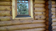 Cabin log home walls, its glass window and a new made cedar wooden shingle  roof Stock Footage